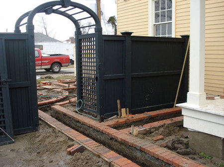 new fence with brick path at New Orleans house