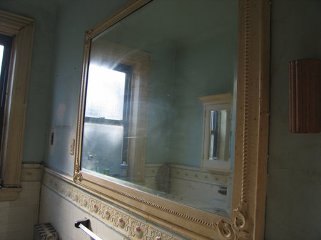 Bathroom window on third floor of TOH NYC project house showing large opening