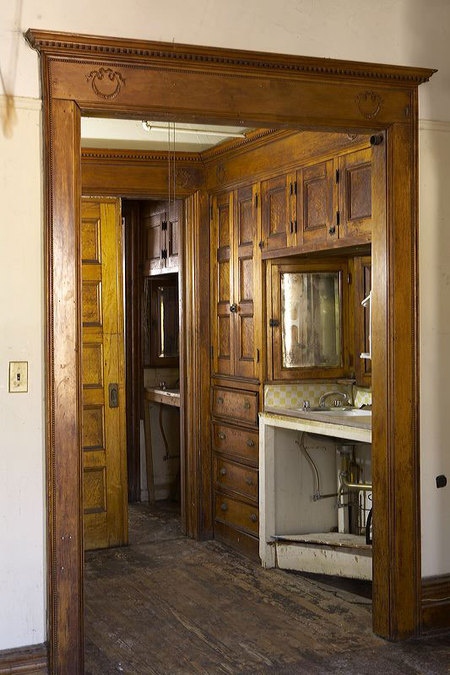 Walk through closet in middle room of Brooklyn brownstone with original turn-of-the century maple and oak woodwork