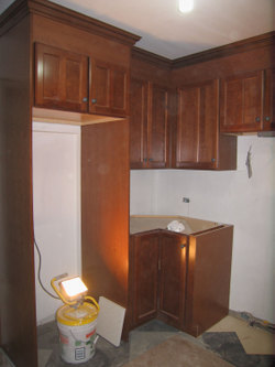 Rental kitchen with stock cabinetry in TOH TV New York City project house