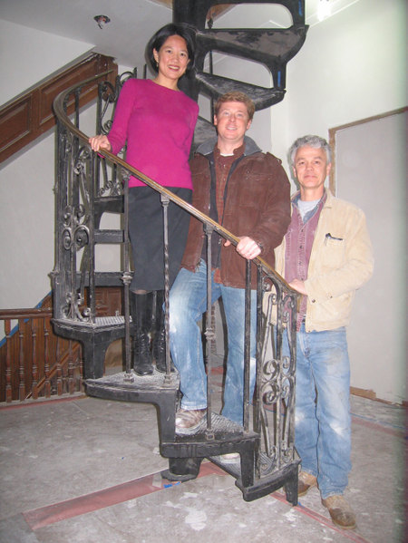 Karen Shen, Kevin O'Connor, and Mike Streaman with newly installed salvaged spiral staircase